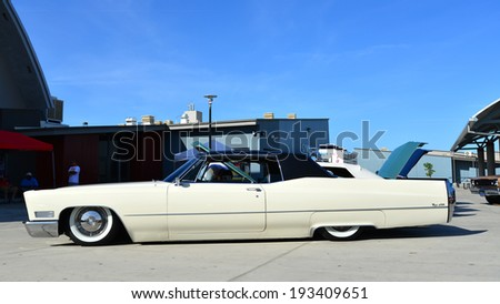 BAKERSFIELD, CA-MAY 17, 2014: The owner of this vintage Cadillac Coupe deVille entered in the South High School Car Show has carried the longer, lower, wider concept to the extreme. - stock photo