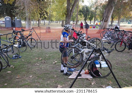 BAKERSFIELD, CA - NOVEMBER 16, 2014: The transition area for the Kern River Duathlon is where contestants switch from running to cycling clothing and pick up their bikes to continue the race. - stock photo