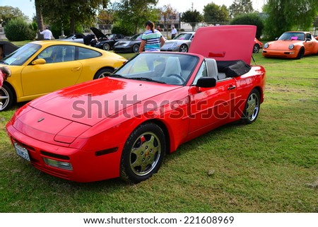 BAKERSFIELD, CA - OCTOBER 4, 2014: A red Porsche 944 is on display at the local Porsche club's  Concours D'Elegance. The 944 is a departure from the classic rear-engined Porsche. - stock photo