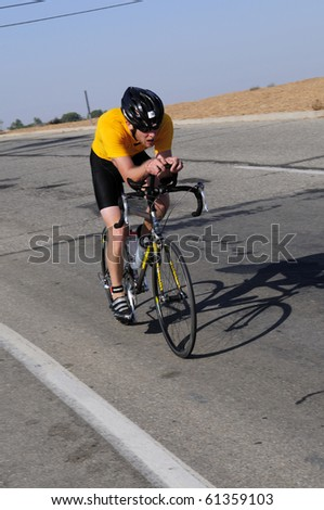 BAKERSFIELD, CA - SEP 18: Cyclist competes in the 40 kilometer bike leg of the 30th Annual Bakersfield Triathlon on September 18, 2010, at Bakersfield, California.