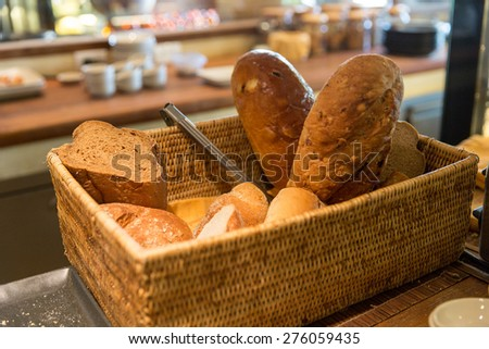 bakery, baking, food and eating concept - basket with bread at restaurant - stock photo