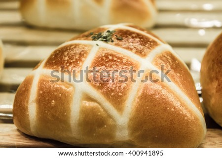 bakery concept with bun on wooden background