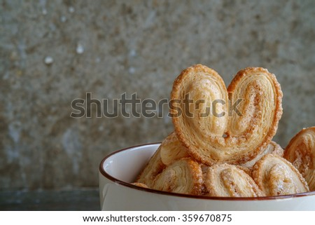 Bakery delicious design from Elephant ear ,Palm leaves, Butterfly shape and Heart about Pies Puff pastry  with butter and  sugar on bowl, Palmier or Coeur de France