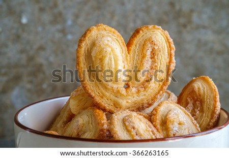 Bakery delicious design from Elephant ear ,Palm leaves, Butterfly shape and Heart about Pies Puff pastry  with butter and  sugar on bowl, Palmier or Coeur de France - stock photo