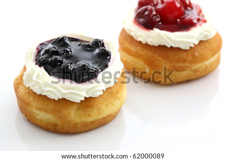 bakery food blueberry and cherry fruit donut on white background