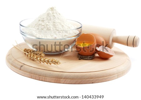 Bakery ingredient. Flour with raw eggs for making dough isolated on a white background. - stock photo