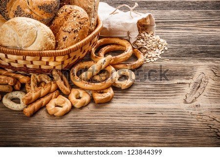 Bakery product assortment on old wooden table - stock photo