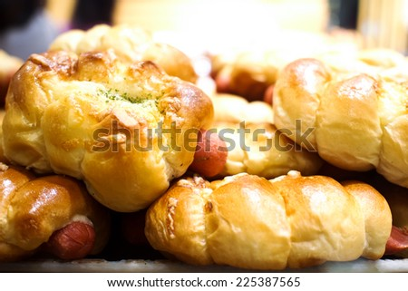 Bakery product assortment with bread loaves, buns, rolls and Danish pastries  - stock photo