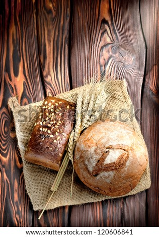 Bakery products on a wooden brown background - stock photo