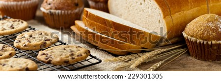Bakery products on wooden table. Selective focus. Panoramic image. - stock photo