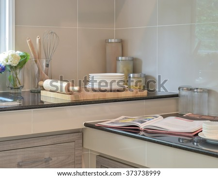 Bakeware set on the black granite top in modern kitchen - stock photo