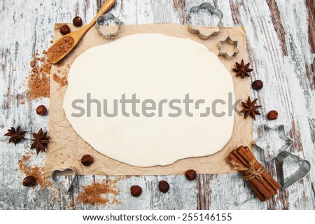 baking background - dough, cookie cutters and spices - stock photo