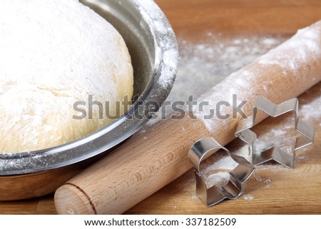 baking background: making cookies with cutter star and bell and rolling pin with copy space