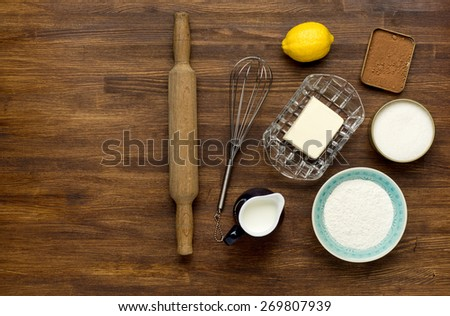 baking background with eggshell and rolling pin on wooden table - stock photo