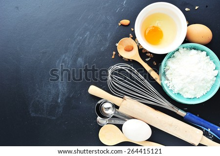 Baking background with flour,eggs,spoon,rolling pin and ingredients for the bakery. - stock photo