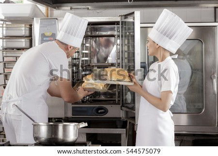 Baking bread in an industrial restaurant kitchen or bakery using a commercial oven