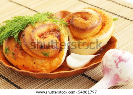 Baking bun with the garlic and the dill - stock photo