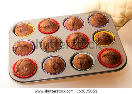 Baking cocoa muffins with colored wrappings