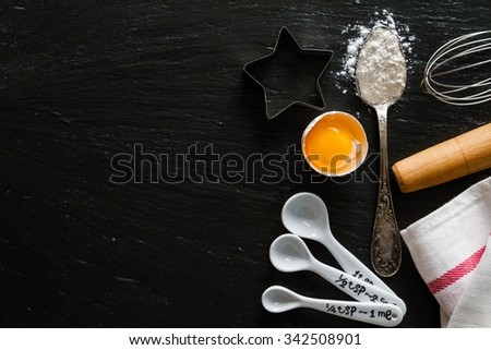 Baking concert on dark stone background, copy space - stock photo