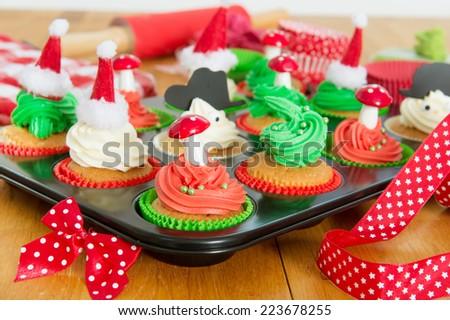Baking cupcakes for Christmas - stock photo