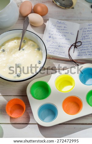 Baking delicious cupcakes with berry fruits - stock photo
