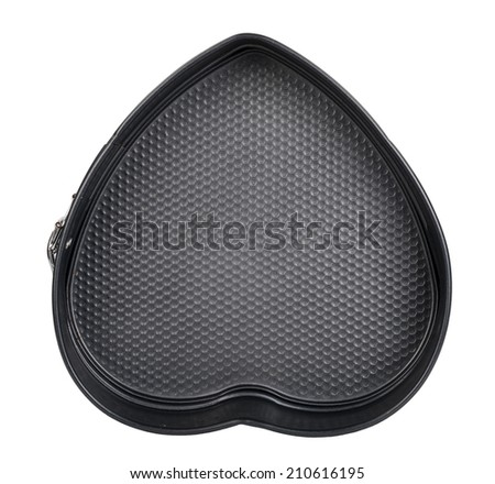 Baking dish in the shape of heart - stock photo