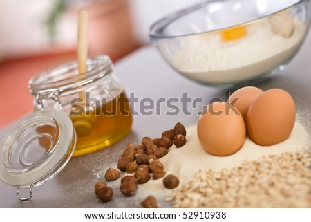 Baking dough ingredients, honey, eggs, flour in kitchen