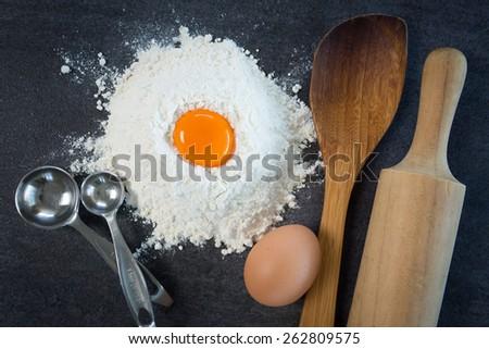 Baking egg flour wooden spoon - stock photo