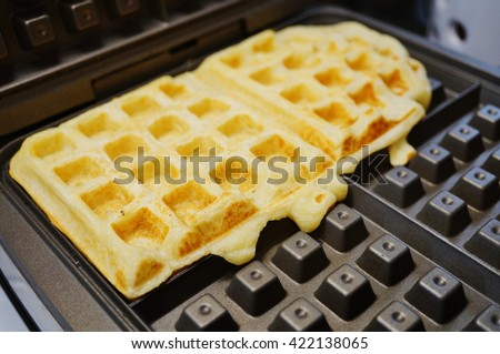 Baking fresh waffles in the waffle-maker