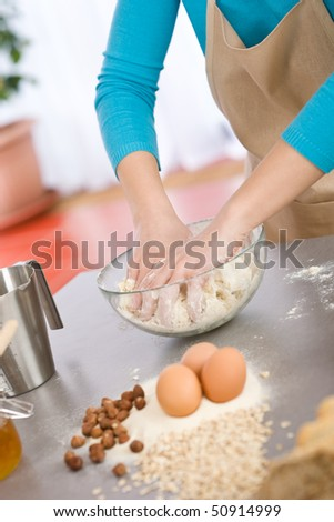 Baking - Hands of woman kneading healthy dough - stock photo
