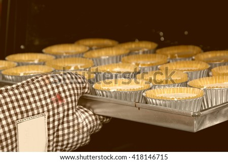 Baking homemade ,Cup cakes baking in oven - stock photo