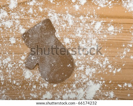 Baking homemade Gingerbread christmas cookies with a shape of a glove - stock photo