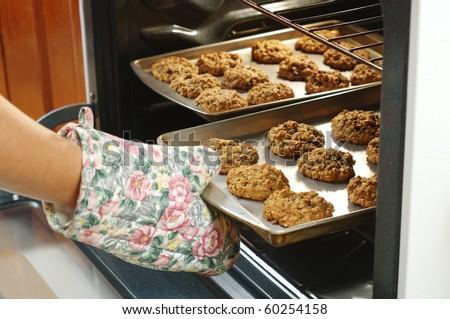 baking homemade oatmeal cookies - stock photo