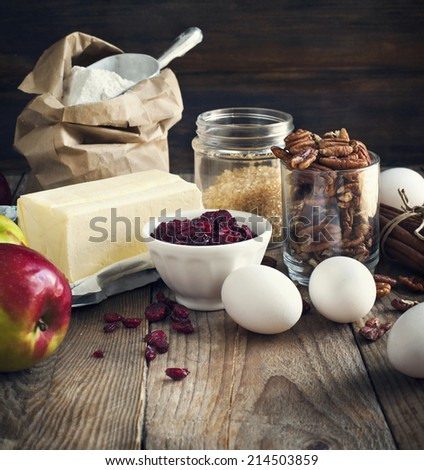 Baking ingredient on wooden background. Fall or winter baking. Toned image - stock photo