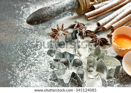 Baking ingredients and tools for dough preparation. Christmas food. Cookie cutters - stock photo