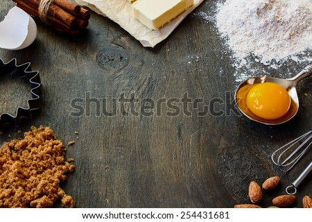 Baking  ingredients - flour, sugar, egg, butter on vintage wood table. Top view. Rustic background with free text space. - stock photo