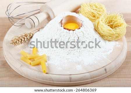 Baking ingredients for cooking on a wooden table. - stock photo