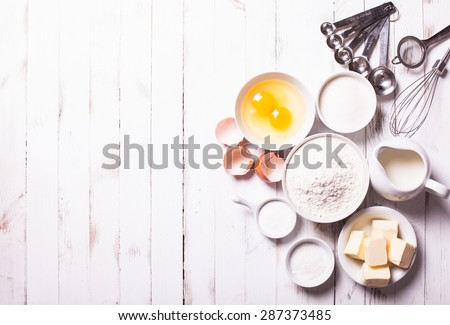 Baking ingredients for pastry on the white table - stock photo