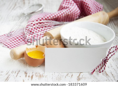baking ingredients on a old white table - stock photo
