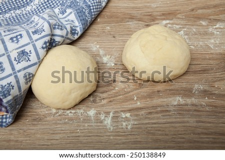 Baking ingredients on a wood table - stock photo