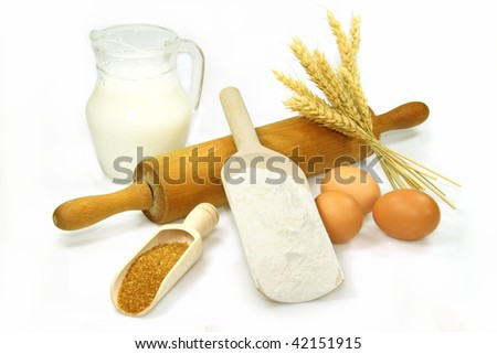 Baking ingredients on bright background - stock photo