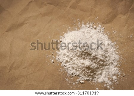 baking ingredients on old brown paper background