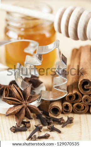 Baking ingredients such as star anise, clove, cinnamon, and honey  for christmas baking. - stock photo