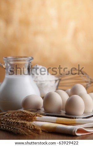 Baking ingredients with a whisk beside. - stock photo