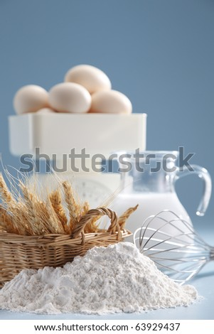Baking ingredients with some wheat and a measuring scale. - stock photo