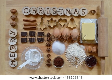 Baking ingredients with wooden pieces and the words MERRY CHRISTMAS burned into them - stock photo