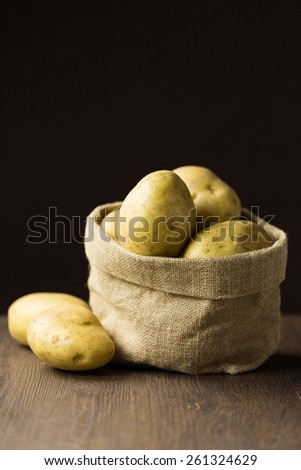 Baking potatoes in a sack - stock photo