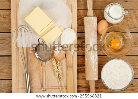 baking preparation, top view of a variety of baking utensils and ingredients - stock photo