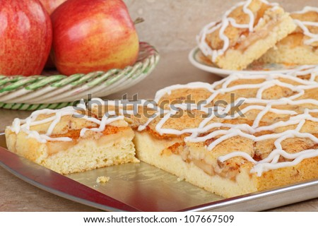 Baking sheet with apple cake on a kitchen counter - stock photo