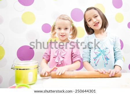 Baking sister, make delicious cake - stock photo